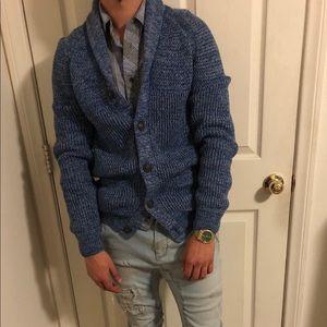 Blue cardigan.